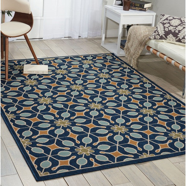 Dominica indoor/outdoor rug in navy situated in reading room