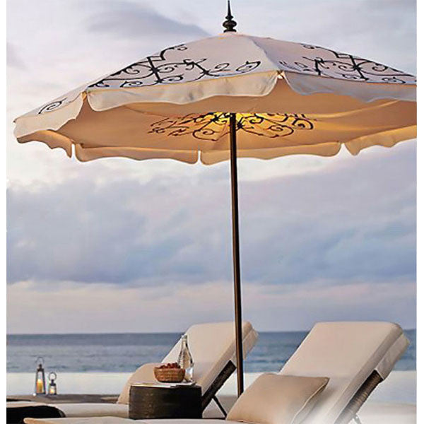 Hand-pinted Alice patio umbrella in Natural on the beach