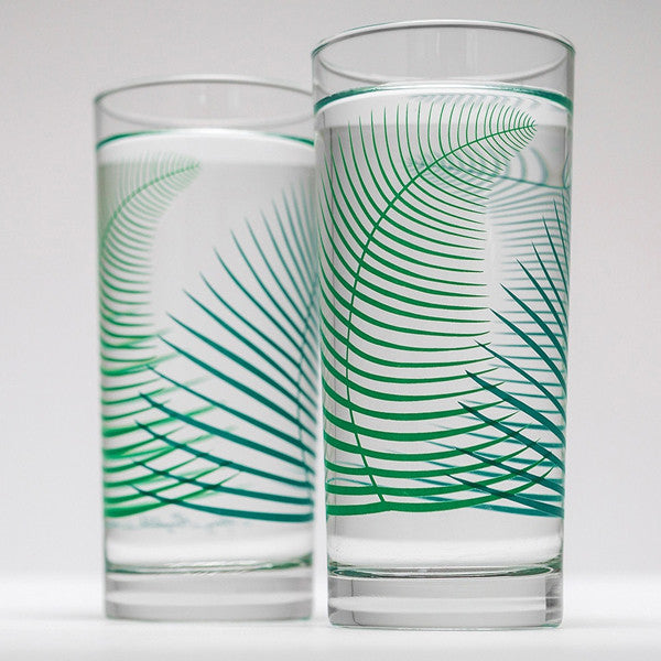 Tall drinking glass with green fern leaf design