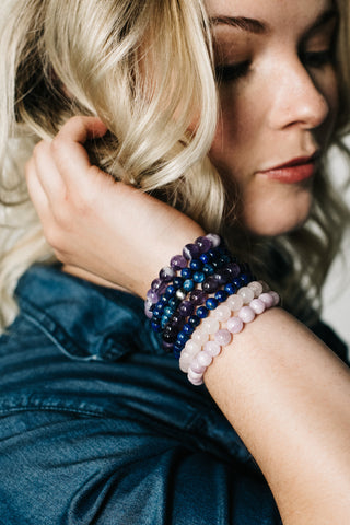 blonde model with colorful bracelet bracelet stack