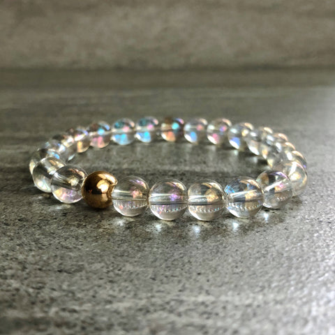 Clear crystal bracelet with gold bead