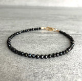 faceted black spinel bracelet with gold clasp
