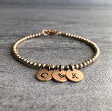 gold initial bracelet with heart charm