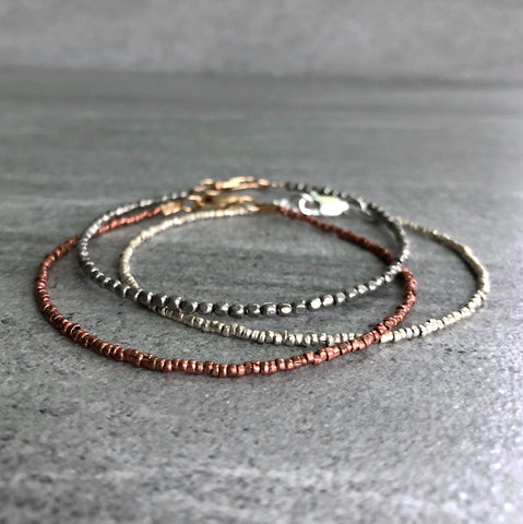 tiny bead bracelet set with metal beads