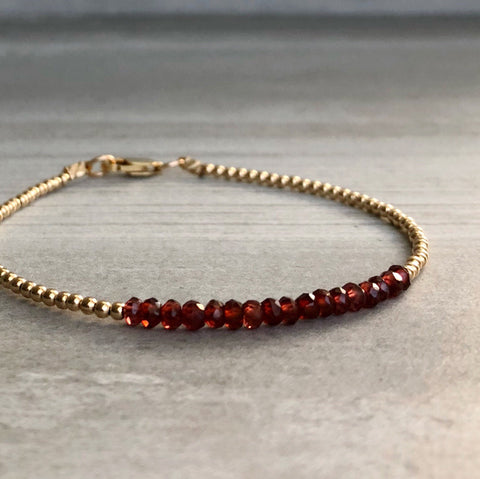 Delicate red Garnet and gold bracelet