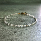 gold and topaz bracelet with small stones