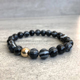 Black agate bracelet with gold bead