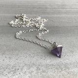 amethyst cone pendant on silver chain