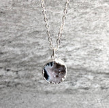 Silver edged crystal pendant necklace