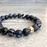 Bulls eye agate bracelet with gold bead