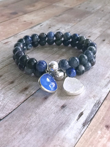 2 blue gemstone bracelets with silver stone charms
