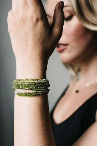 green peridot bracelet stack on blonde model
