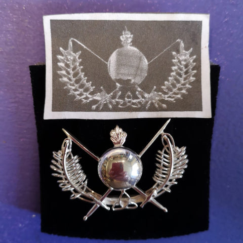 A before and after of the Old Military Brooch - a piece of jewellery restored in Ireland and brought to life.