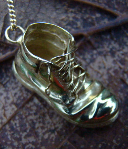 An 18ct gold boot, handcrafted by Elena Brennan Jewellery as a special commission.