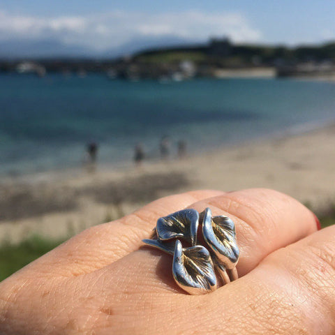 Gorgeous picture of a happy Elena Brennan Jewellery customer wearing her Lily ring on her finger.