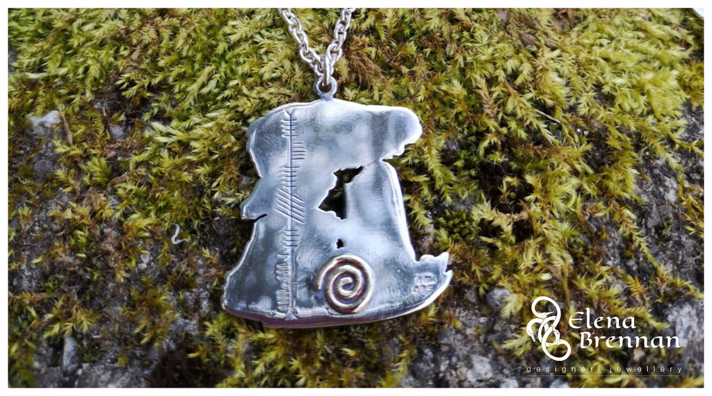 The Luna Goddess Spiral and Ogham writing is incorporated into the design.