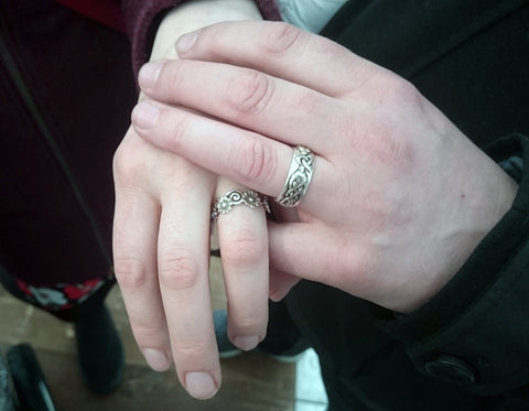 Happy couple with their engagement rings, handcrafted and designed by Elena Brennan Jewellery in Cavan, Ireland.