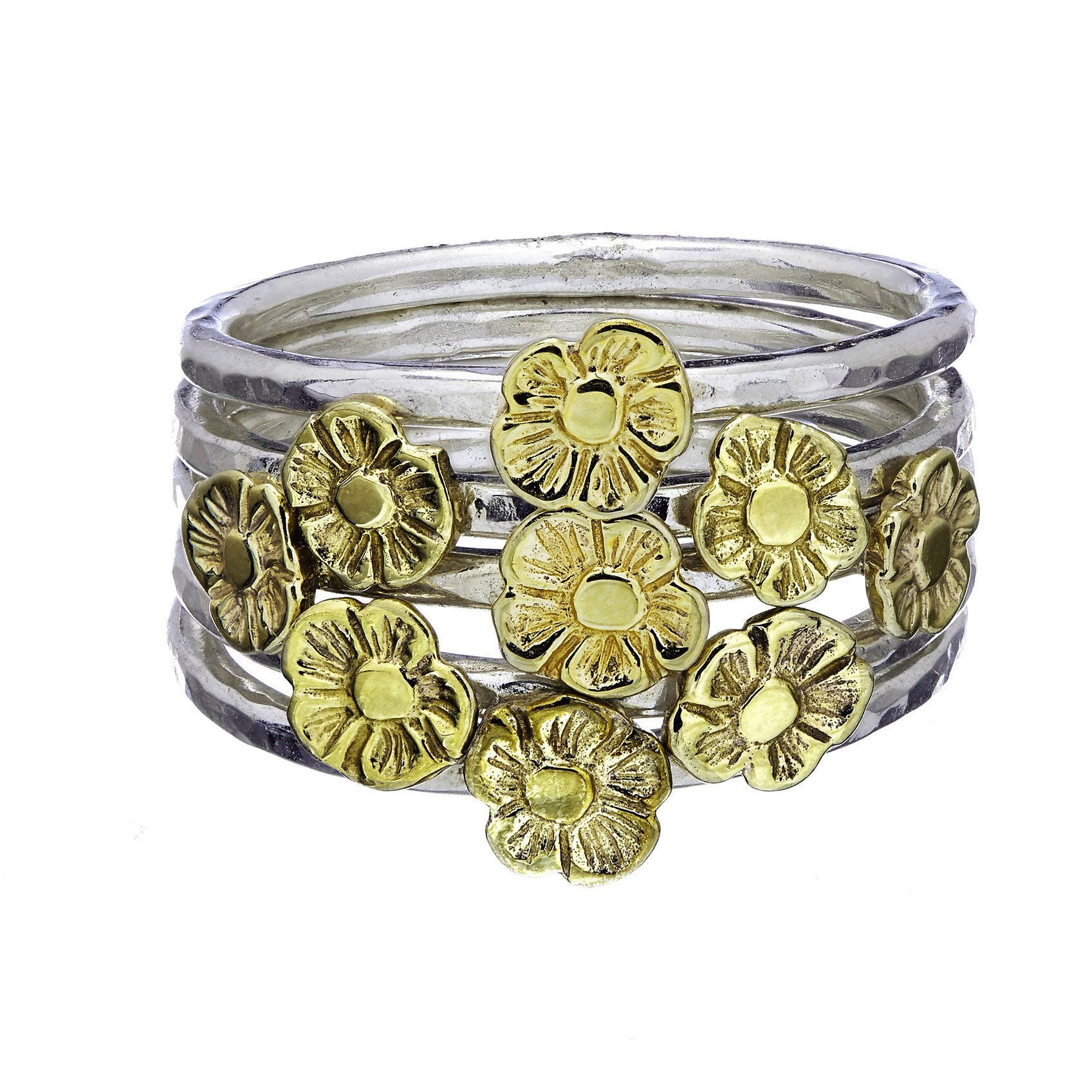 Tiny Flower Stacking Rings worn together forming a beautiful bunch.