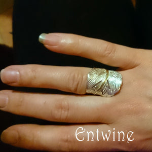 Sterling Silver Angel Feather Ring with gold plated stem detailing.