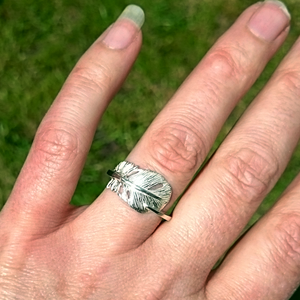 """Cherish"" is a sterling silver angel feather ring. This gift from the Angels will bring hope and joy to all. Irish handmade jewellery by Elena Brennan made in Cavan Ireland."