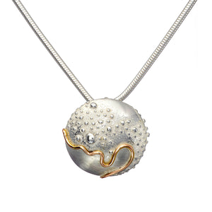 Cúrsa an tSaoil  medium domed pendant with a shiny Silver finish.