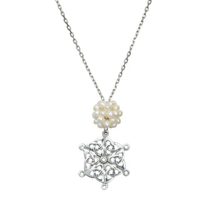 Celtic Snowflake Pendant detailing of the Trinity Knot Snowflake and Freshwater Pearl snowball.