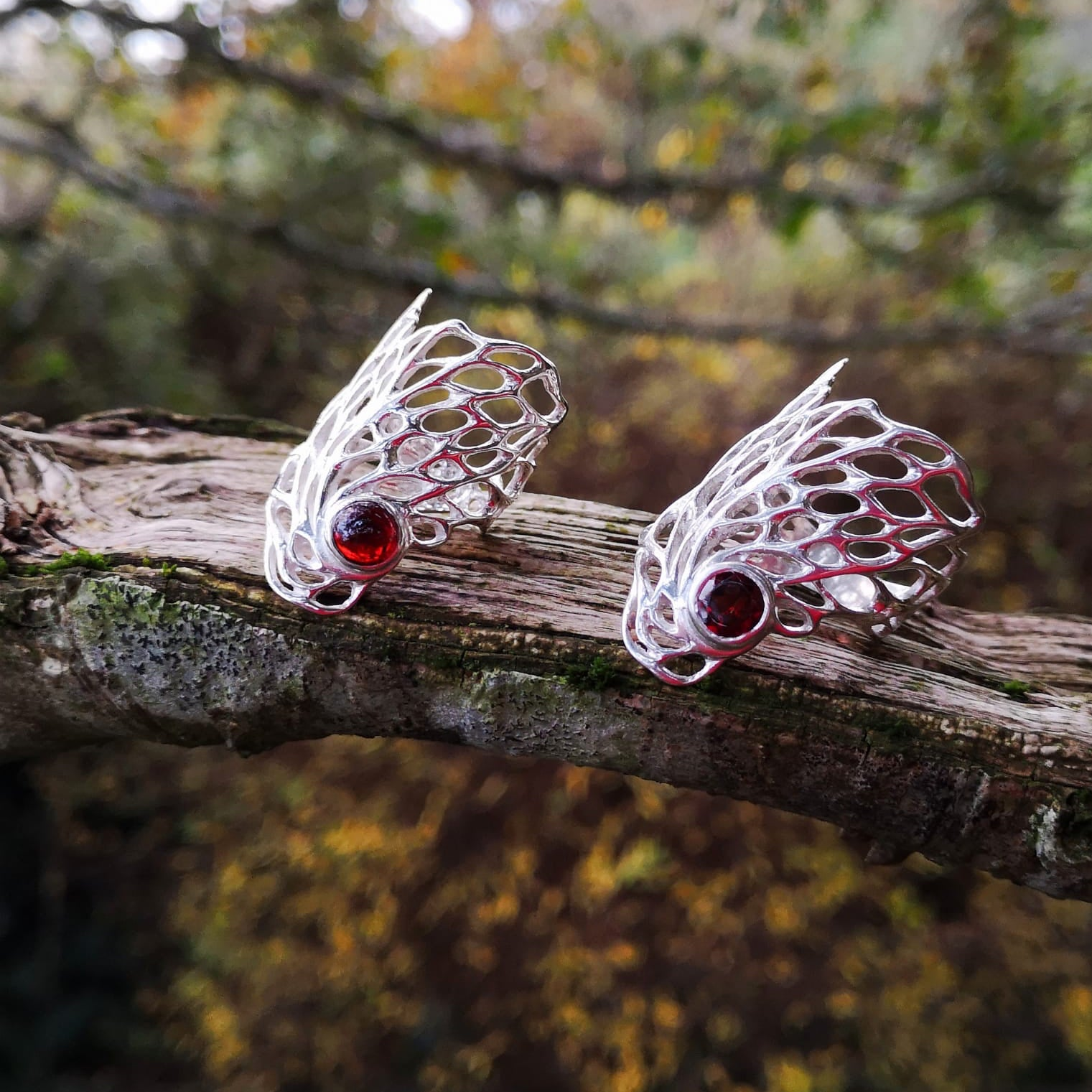 Ethereal Gossamer Stament Rings with different cuts of garnet gemstones nestled within.