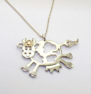 Daisy the Cow Pendant complete with a dainty 14ct gold flower, a gorgeous gift.