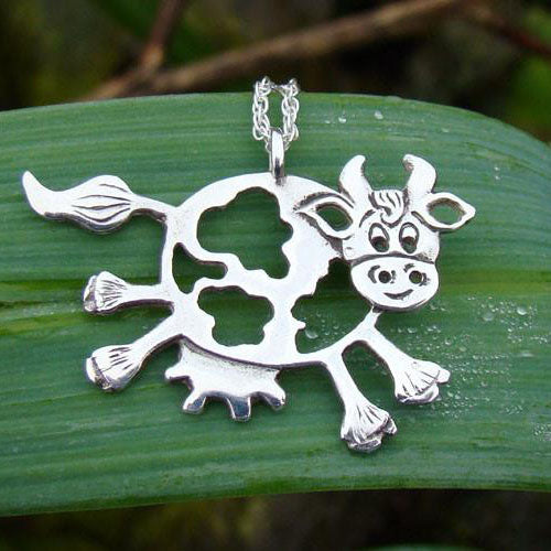 Daisy the Cow Pendant hanging on an 18 inch chain, handcrafted from sterling silver.