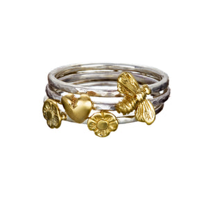 Stacking Rings with Gold Celtic Symbols