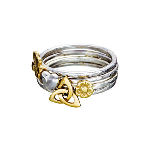 Various sterling silver stacking rings with 9ct Gold Irish Symbols.