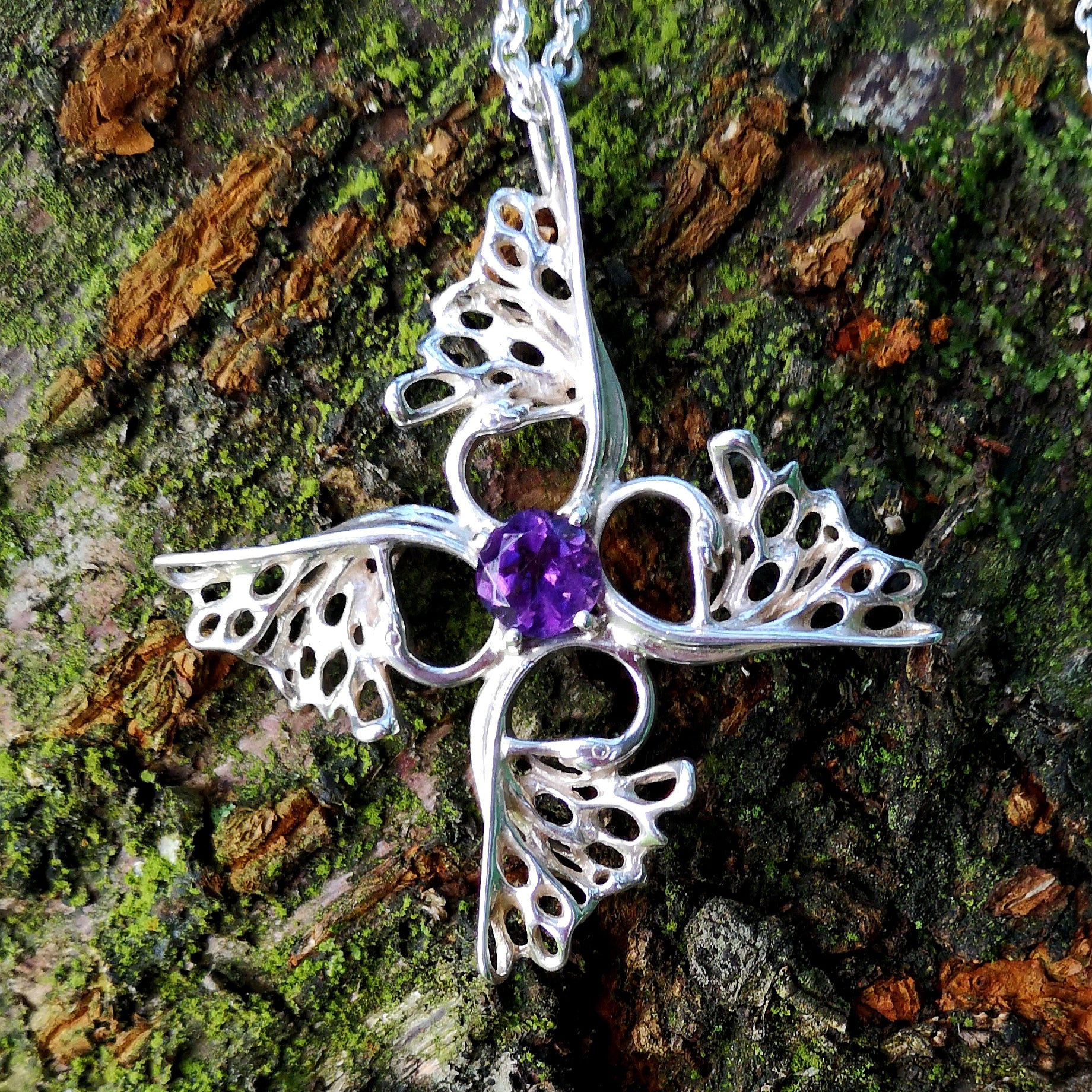 Crusader Children of Lir Cross handcrafted from Sterling Silver with Amethyst gemstone setting.