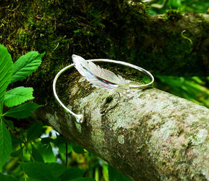 The Earth Angel Feather Bangle can also be adjusted to fit your wrist.
