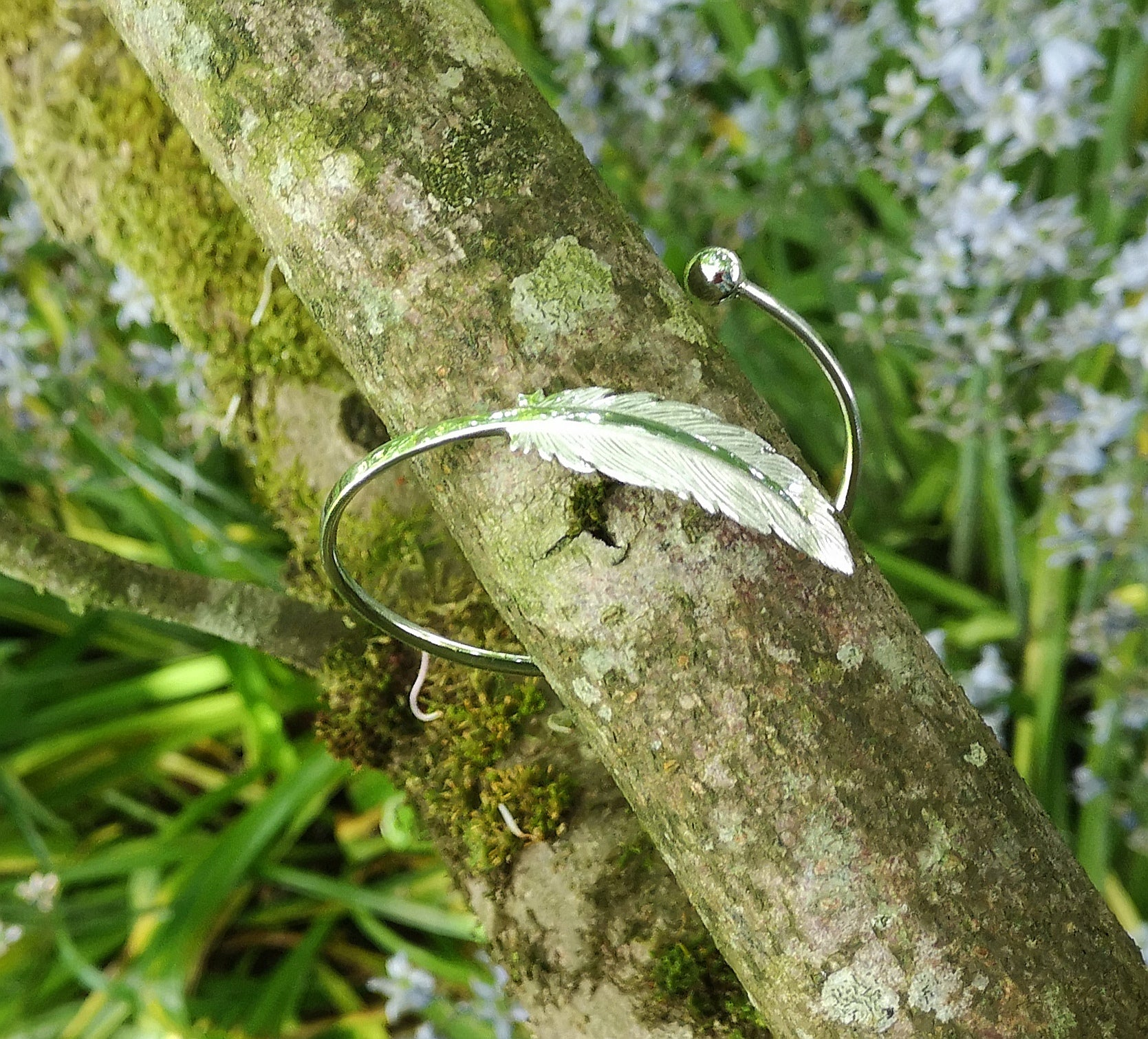 Earth Angel Feather Bangle handcrafted in sterling silver by Elena Brennan Jewellery.