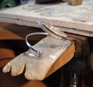 The handcrafted Angel Feather Bangle displayed on Irish Jewellery Designer Elena Brennan's Studio.
