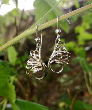 Handmade sterling silver Swan Drop Earrings are handcrafted by Irish Jewellery Designer Elena Brennan.