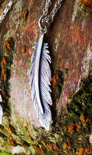 A close up of the Sterling Silver Earth Angel Feather Pendant.