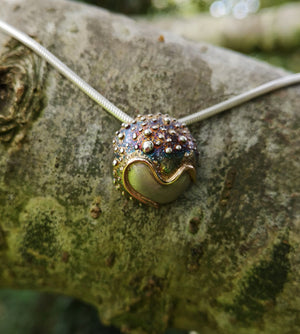 The Small Cúrsa an tSaoil Pendant is handmade from sterling silver by Elena Brennan Jewellery.