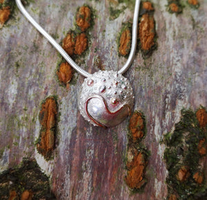 A closer look at the Small Cúrsa an tSaoil Journey of Life Pendant handcrafted from sterling silver by Elena Brennan Jewellery.