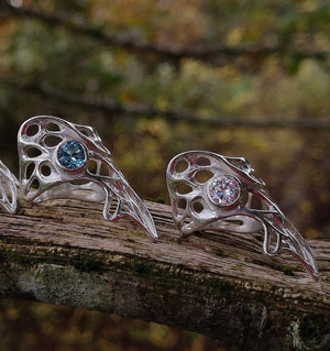 Gorgeous Dainty Gossamer statement Celtic rings with Blue Topaz and cubic zirconia gemstone settings.