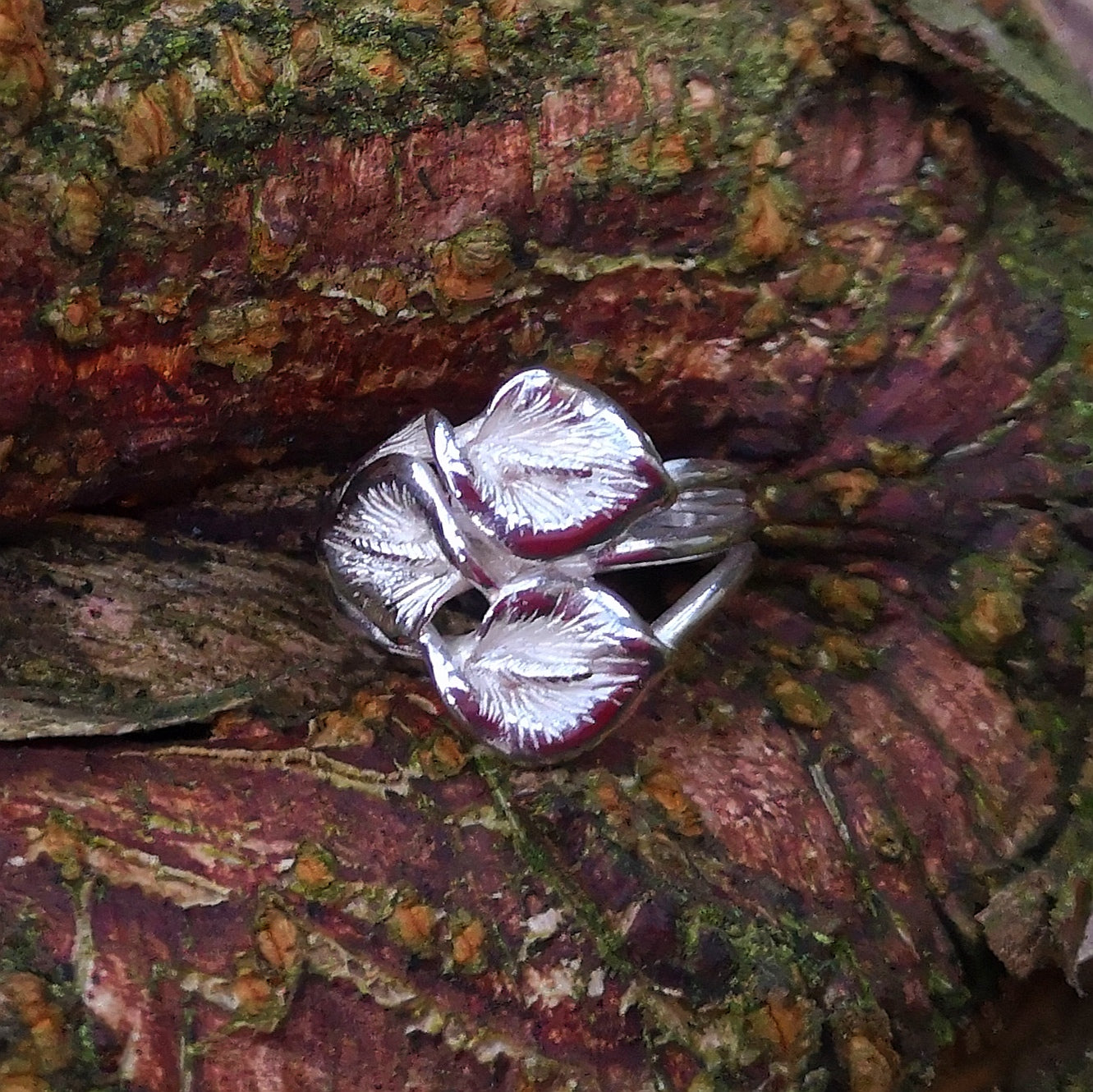 Trinity, peace lily sterling silver ring, by Elena Brennan Jewellery.