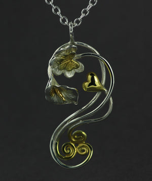 Éireann Pendant with an 18 inch chain with 14ct gold Irish Symbols