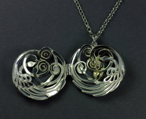 Swan Sterling Silver Swan Locket Pendant showing gold heart detail in the center. Irish made Jewellery from Elena Brennan.