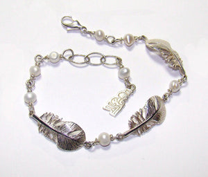 Sterling Silver Baby Angel Feather Bracelet with pearl detailing.