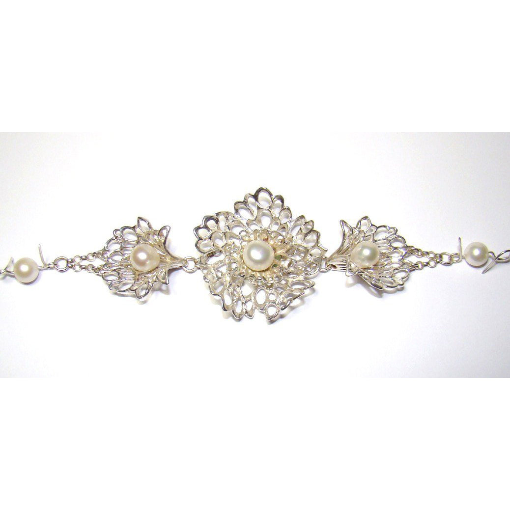 Petals & Pearls Gossamer Lacy Flower Bracelet is a handcrafted timeless piece.