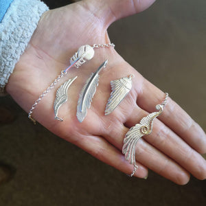 An idea of the sizing of the different angel wings and feathers available on Elena Brennan Jewellery.