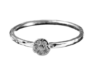 One Tiny Flower Stacking Ring in Sterling Silver.