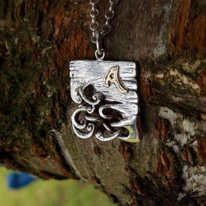 A Bog Book Pendant with 14ct gold letter handmade by Irish Jewellery Designer Elena Brennan.