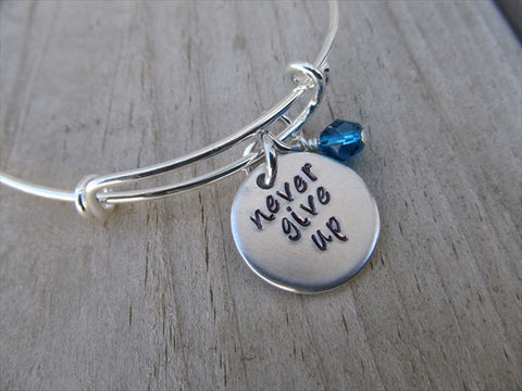 "Never Give Up Bracelet- ""never give up""  - Hand-Stamped Bracelet- Adjustable Bangle Bracelet with an accent bead of your choice"