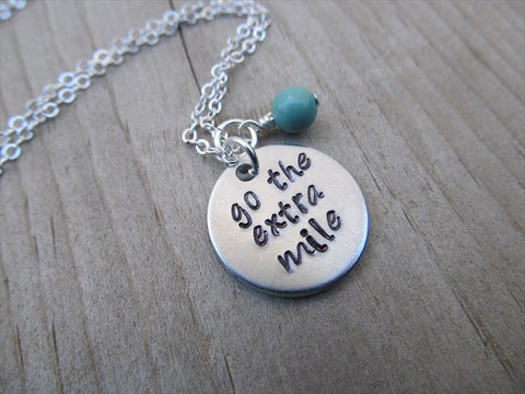 "Go The Extra Mile Necklace- ""go the extra mile- Hand-Stamped Necklace with an accent bead in your choice of colors"